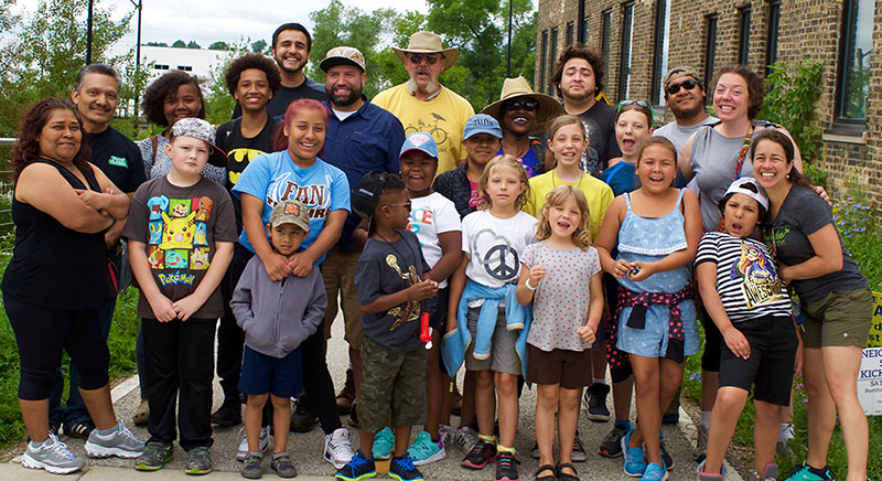 Building community at the Urban Ecology Center — campers from the Young Scientist Club Family Camping Trip